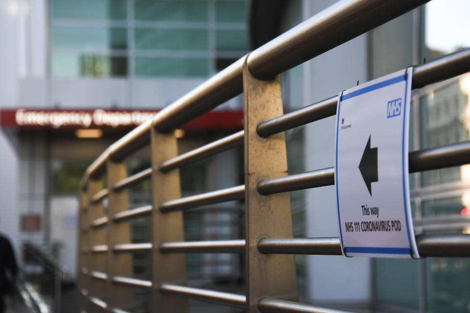 A sign indicating a Coronavirus Pod is seen outside the London University College Hospital, in London, Friday, March 6, 2020. Fearing a possible shortage in protective equipment, health ministers from the European Union are holding an emergency meeting to try to improve their collective response to the novel coronavirus outbreak. (AP Photo/Alberto Pezzali)