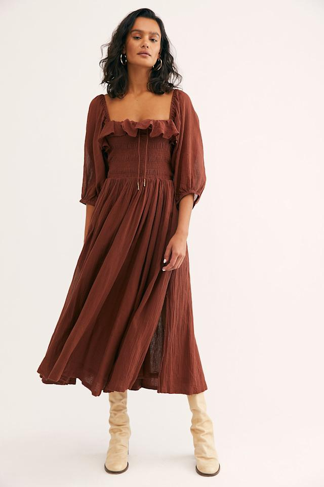 "<p>This romantic <a href=""https://www.popsugar.com/buy/Oasis-Midi-Dress-478099?p_name=Oasis%20Midi%20Dress&retailer=freepeople.com&pid=478099&price=118&evar1=fab%3Aus&evar9=45320445&evar98=https%3A%2F%2Fwww.popsugar.com%2Ffashion%2Fphoto-gallery%2F45320445%2Fimage%2F46582380%2FOasis-Midi-Dress&list1=shopping%2Cfall%20fashion%2Cdresses%2Cfall&prop13=mobile&pdata=1"" rel=""nofollow"" data-shoppable-link=""1"" target=""_blank"" class=""ga-track"" data-ga-category=""Related"" data-ga-label=""https://www.freepeople.com/shop/oasis-midi-dress/?category=whats-new&amp;color=022&amp;quantity=1&amp;type=REGULAR"" data-ga-action=""In-Line Links"">Oasis Midi Dress</a> ($118) also comes in black.</p>"