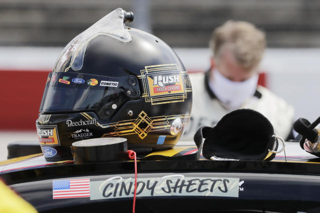 The name of Cindy Sheets covers the name of driver Clint Bowyer before the NASCAR Cup Series auto race Sunday, May 17, 2020, in Darlington, S.C. The names of health care workers across the country have been substituted for the drivers' name above the door on each of the 40 cars. (AP Photo/Brynn Anderson)
