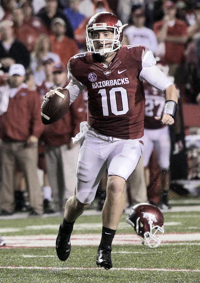 Arkansas quarterback Brandon Allen prepares to pass during the fourth quarter of an NCAA college football game against Texas A&M in Fayetteville, Ark., Saturday, Sept. 28, 2013. Texas A&M defeated Arkansas 45-33. (AP Photo/Danny Johnston)