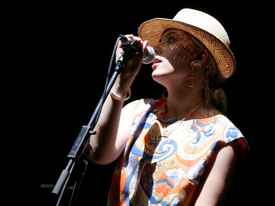 Scarlett Johansson sings with The Jesus And Mary Chain at Coachella Music Festival in 2007Getty Images