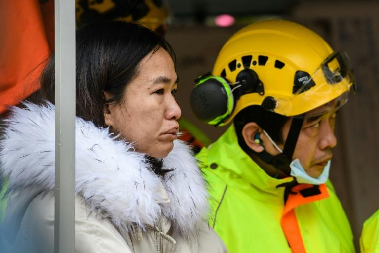 Emergency workers were still pulling bodies from the 12-storey apartment block after its lower floors pancaked during Tuesday's quake