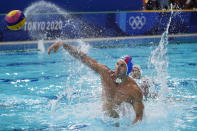 Italy's Pietro Figlioli (4) shoots during a preliminary round men's water polo match against the United States at the 2020 Summer Olympics, Thursday, July 29, 2021, in Tokyo, Japan. (AP Photo/Mark Humphrey)