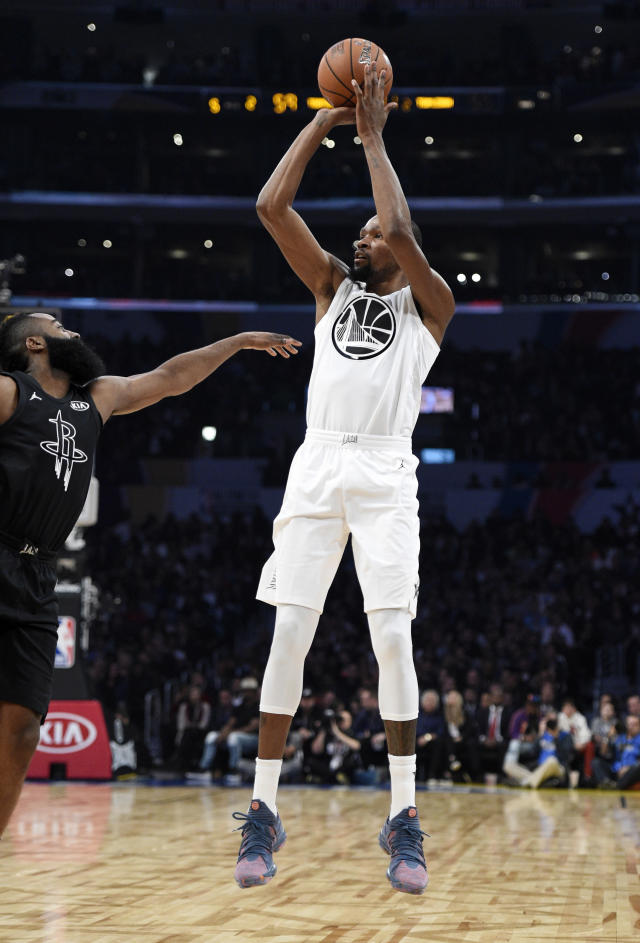 Team LeBron's Kevin Durant, right, of the Golden State Warriors, shoots as Team Stephen's James Harden, of the Houston Rockets, defends during the first half of an NBA All-Star basketball game, Sunday, Feb. 18, 2018, in Los Angeles. (AP Photo/Chris Pizzello)