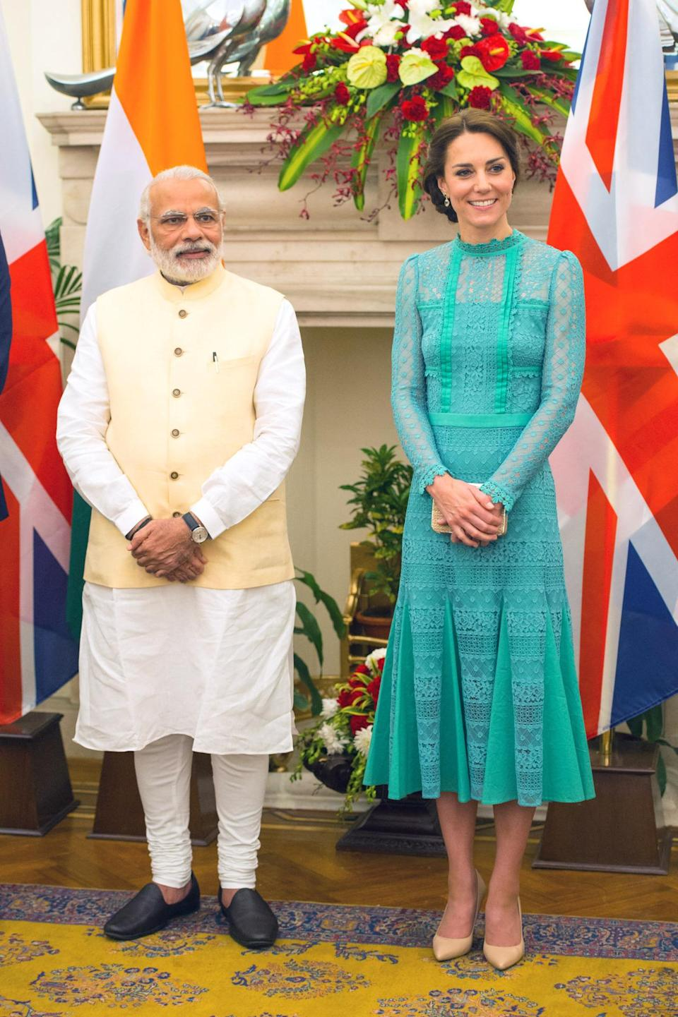 <p>The Duchess donned a high-necked mint Temperley London dress for a lunch with India's Prime Minister. Nude L.K. Bennett accessories polished off the look. </p><p><i>[Photo: PA]</i></p>