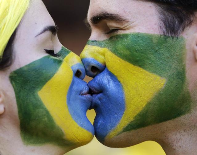 10ThingstoSeeSports - Brazilian soccer team supporters kiss before the World Cup round of 16 soccer match between Brazil and Chile at the Mineirao Stadium in Belo Horizonte, Brazil, Saturday, June 28, 2014. (AP Photo/Andre Penner, File)