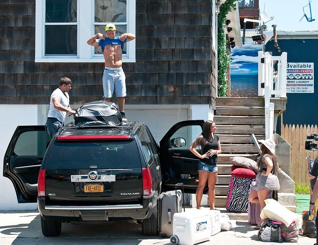"""Of course, Mike """"The Situation"""" Sorrentino always makes time to show off his famous abs. Can you imagine this crew roughing it in the wild? <a href=""""http://www.infdaily.com"""" target=""""new"""">INFDaily.com</a> - July 27, 2011"""