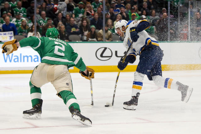 St. Louis Blues center Jordan Kyrou, right, shoots and scores a goal as Dallas Stars defenseman Jamie Oleksiak, left, defends during the second period of an NHL hockey game in Dallas, Friday, Feb. 21, 2020. (AP Photo/Ray Carlin)