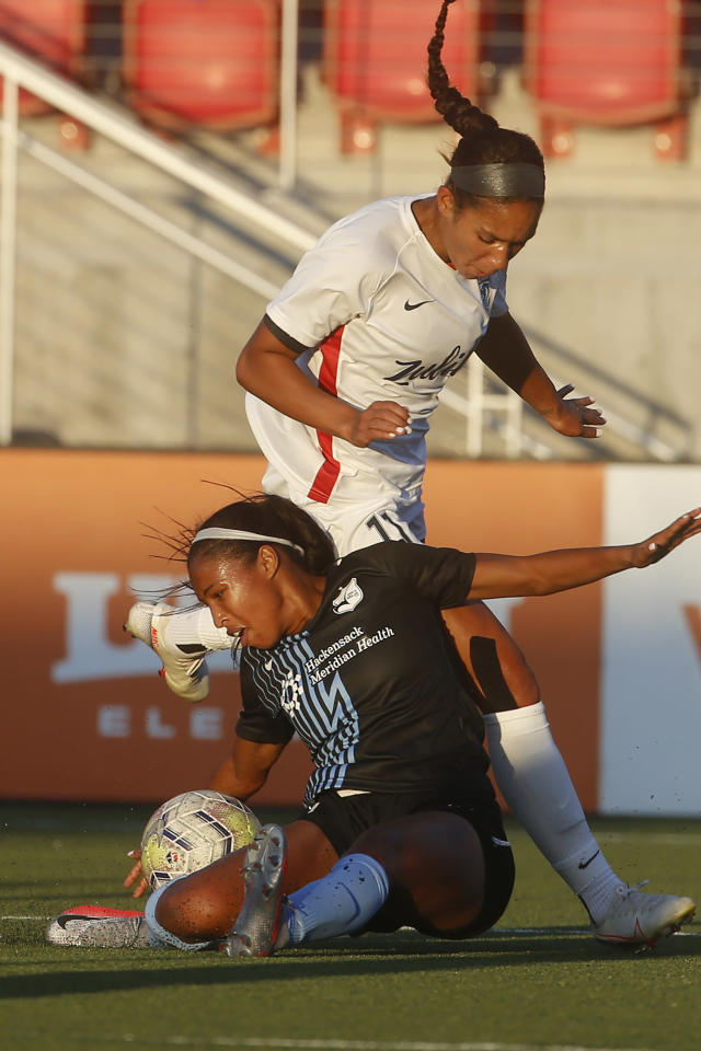 Sky Blue FC forward Midge Purce, foreground, works for the ball against OL Reign forward Darian Jenkins (11) during the first half of an NWSL Challenge Cup soccer match at Zions Bank Stadium on Tuesday, June 30, 2020, in Herriman, Utah. (AP Photo/Rick Bowmer)