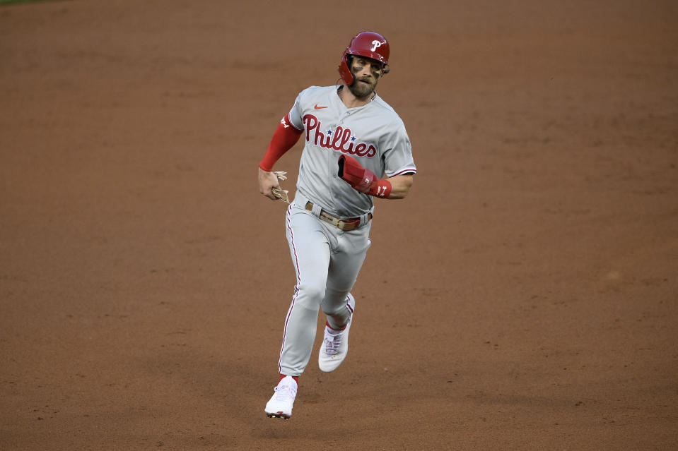 Philadelphia Phillies' Bryce Harper runs to third on a single by J.T. Realmuto during the third inning of the second baseball game of the team's doubleheader against the Washington Nationals, Tuesday, Sept. 22, 2020, in Washington. (AP Photo/Nick Wass)