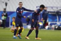 France's Kingsley Coman, right, and Antoine Griezmann react after their side's fourth goal during the UEFA Nations League soccer match between France and Sweden at the Stade de France stadium in Saint-Denis, northern Paris, Tuesday, Nov. 17, 2020. France won 4-2. (AP Photo/Francois Mori)