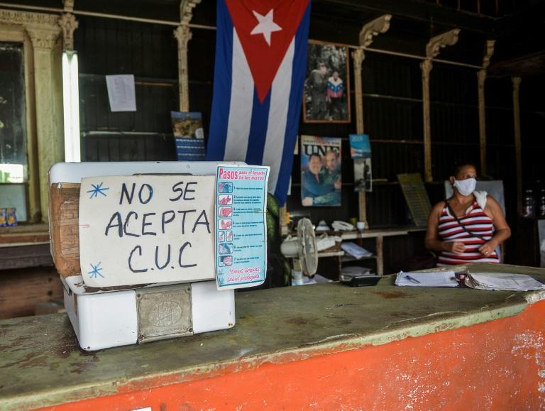 """A sign outside a Havana grocery store reads """"CUC are not accepted"""" in September 2020"""