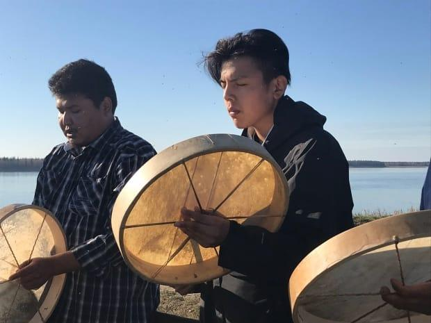 A drummer performs at a ceremony in 2019 to commemorate children who died at Sacred Heart Mission school in Fort Providence.