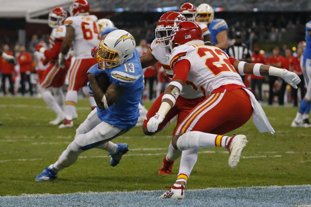Los Angeles Chargers wide receiver Keenan Allen, left, scores a touchdown during the second half of an NFL football game against the Kansas City Chiefs, Monday, Nov. 18, 2019, in Mexico City. (AP Photo/Eduardo Verdugo)