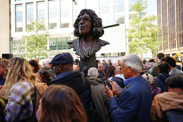 People at the unveiling of the statue of Betty Campbell, Wales' first black headteacher (Ben Birchall/PA)