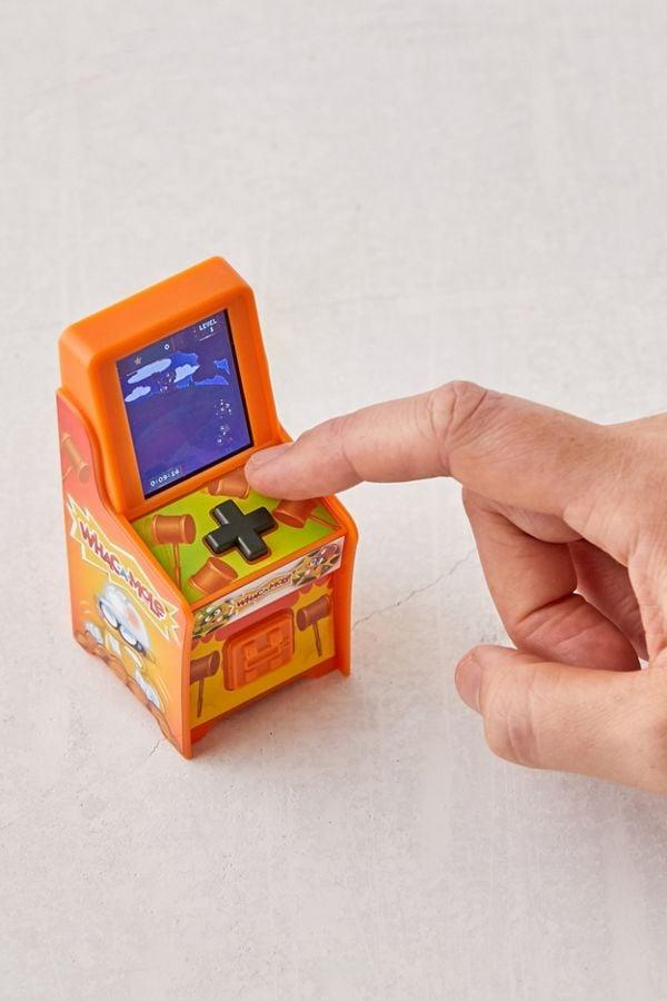 "<p>This adorable <a href=""https://www.popsugar.com/buy/Whac--Mole-Tiny-Arcade-Game-504080?p_name=Whac-A-Mole%20Tiny%20Arcade%20Game&retailer=urbanoutfitters.com&pid=504080&price=25&evar1=savvy%3Aus&evar9=45526638&evar98=https%3A%2F%2Fwww.popsugar.com%2Fhome%2Fphoto-gallery%2F45526638%2Fimage%2F46782062%2FWhac--Mole-Tiny-Arcade-Game&list1=shopping%2Cgifts%2Choliday%2Cstocking%20stuffers%2Cgift%20guide%2Cgifts%20for%20men&prop13=api&pdata=1"" rel=""nofollow"" data-shoppable-link=""1"" target=""_blank"" class=""ga-track"" data-ga-category=""Related"" data-ga-label=""https://www.urbanoutfitters.com/shop/whac-a-mole-tiny-arcade-game?category=new-music-tech&amp;color=080&amp;type=REGULAR"" data-ga-action=""In-Line Links"">Whac-A-Mole Tiny Arcade Game</a> ($25) will keep him smiling for hours.</p>"