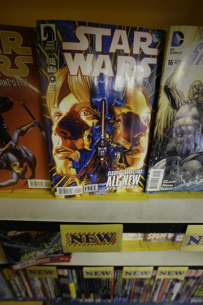 The new Star Wars comic is displayed at Fat Jack's Comicrypt, Wednesday, Jan. 9, 2013, in Philadelphia. Writer Brian Wood, artist Carlos D'Anda and Dark Horse Comics launch a new monthly series Wednesday that focuses on Luke Skywalker, Princess Leia, Han Solo and Chewbacca, as well as droids R2-D2 and C3P0, as they seek to establish a foothold for the rebellion in the aftermath of the Death Star's destruction. (AP Photo/Matt Rourke)
