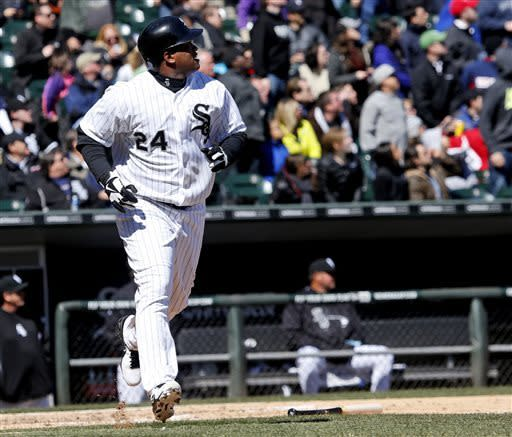 Chicago White Sox's Dayan Viciedo watches his two-run home run off Kansas City Royals starting pitcher Ervin Santana during the fourth inning of a baseball game Wednesday, April 3, 2013, in Chicago. (AP Photo/Charles Rex Arbogast)