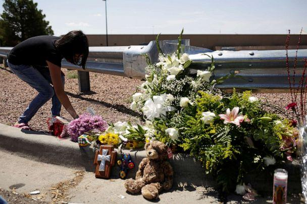 PHOTO: A woman places flowers at the site of a mass shooting at a Walmart in El Paso, Texas, Aug. 4, 2019. (Jose Luis Gonzalez/Reuters)