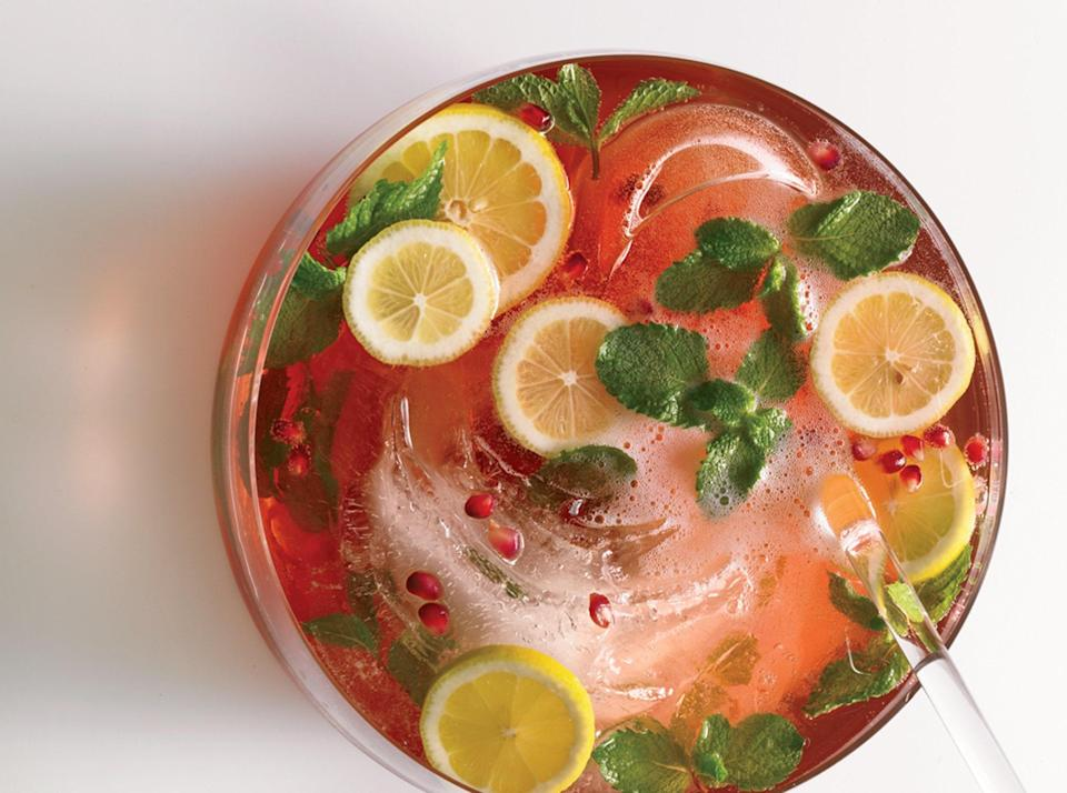 """White rum lends a light, fragrant kick to this punch of pomegranate and sparkling wine. A handful of mint leaves adds a pop of color and a springy flavor. <a href=""""https://www.epicurious.com/recipes/food/views/pomegranate-champagne-punch-240761?mbid=synd_yahoo_rss"""" rel=""""nofollow noopener"""" target=""""_blank"""" data-ylk=""""slk:See recipe."""" class=""""link rapid-noclick-resp"""">See recipe.</a>"""