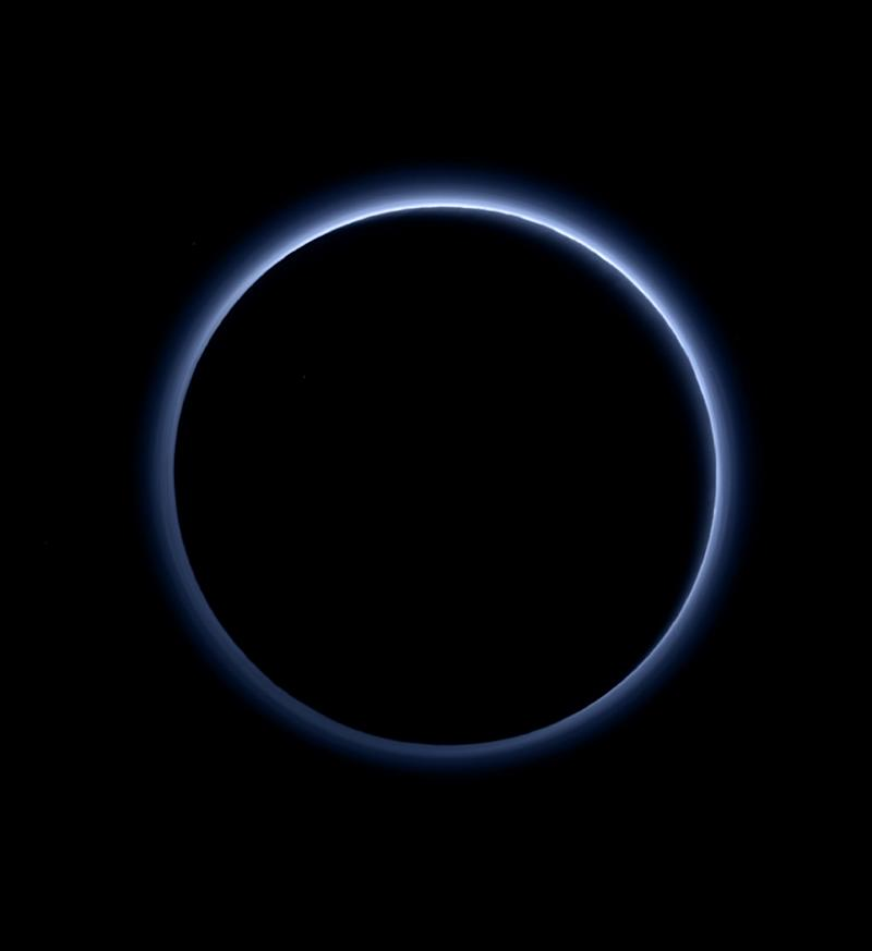 This image released by NASA on October 8, 2015, shows Pluto's haze layer and its blue color in a picture taken by the New Horizons Ralph/Multispectral Visible Imaging Camera