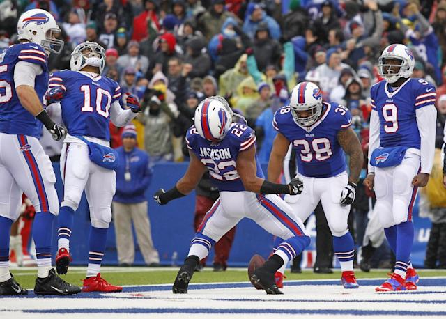 Buffalo Bills running back Fred Jackson (22) celebrates his touchdown with teammates Lee Smith (85), Robert Woods (10), Frank Summers (38) and Thad Lewis (9) during the first half of an NFL football game against the Miami Dolphins on Sunday, Dec. 22, 2013, in Orchard Park, N.Y. (AP Photo/Bill Wippert)
