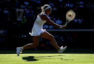 Kiki Bertens of The Netherlands plays a forehand in her Ladies' Singles first round match against Mandy Minella of Luxembourg during Day two of The Championships - Wimbledon 2019 at All England Lawn Tennis and Croquet Club on July 02, 2019 in London, England. (Photo by Matthias Hangst/Getty Images)