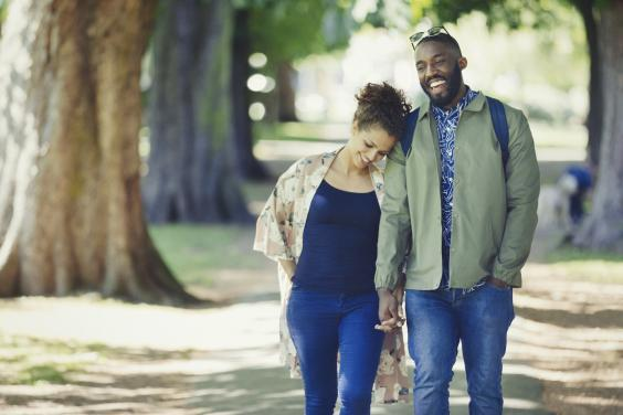 Couple walking in the park (iStock)