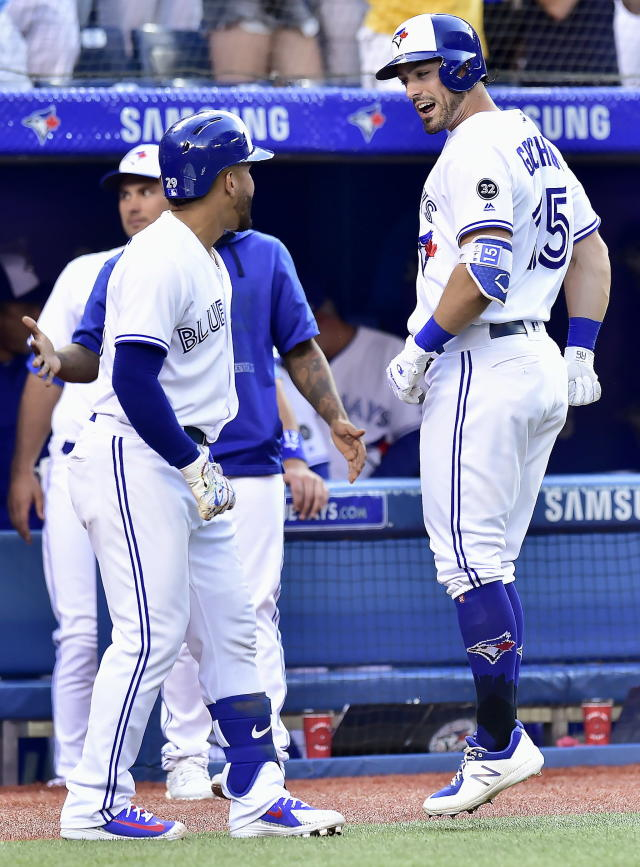 Toronto Blue Jays left fielder Randal Grichuk (15) celebrates with teammates after his solo home run during fifth-inning baseball game action against the Baltimore Orioles in Toronto, Friday, July 20, 2018. (Frank Gunn/The Canadian Press via AP)