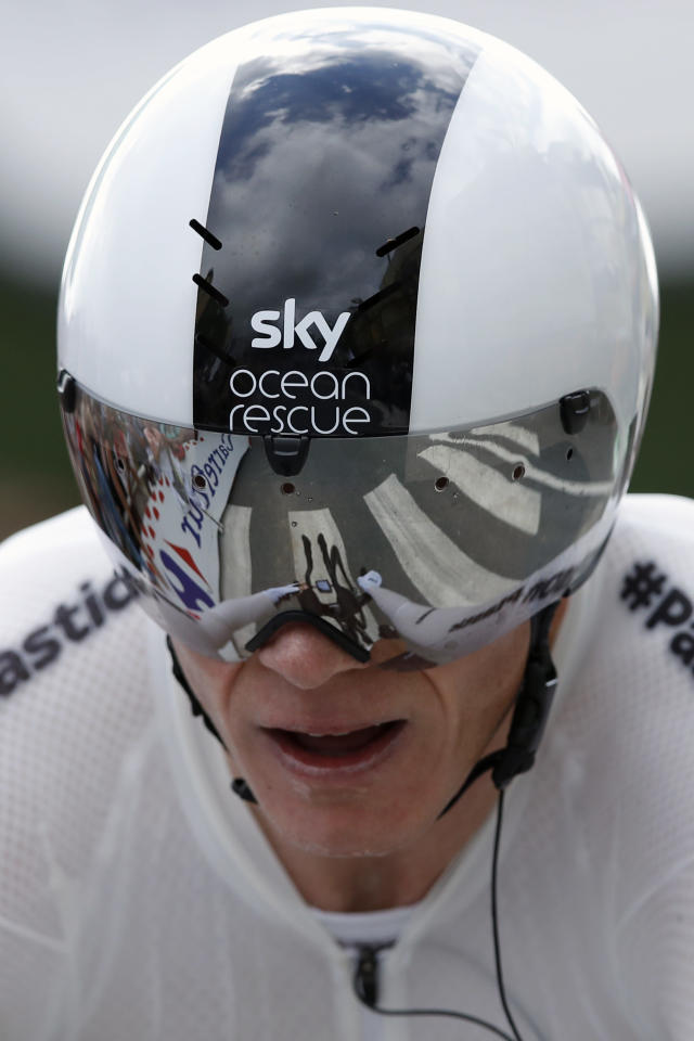Britain's Chris Froome rides to cross the finish line during the twentieth stage of the Tour de France cycling race, an individual time trial over 31 kilometers (19.3 miles) with start in Saint-Pee-sur-Nivelle and finish in Espelette, France, Saturday, July 28, 2018. (AP Photo/Christophe Ena)