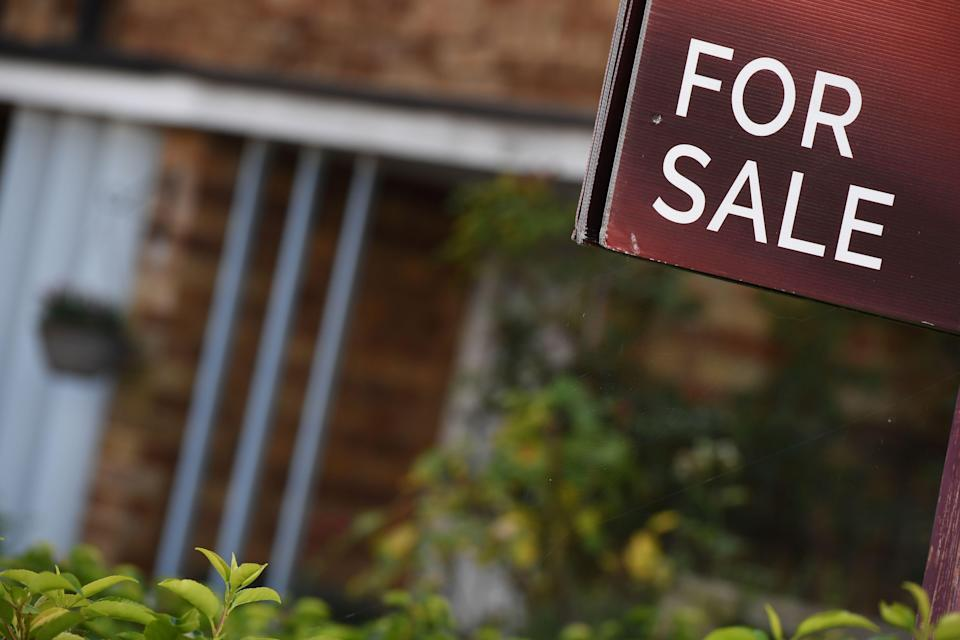 An estate agent's 'for sale' board stands outside a residential building in London. Photo: Chris J Ratcliffe/AFP/Getty Images