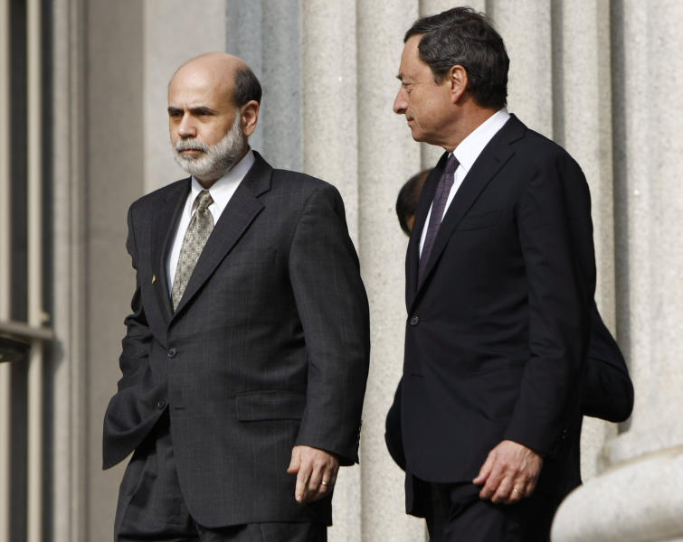 FILE-In this Friday, April 11, 2008, file photo, Federal Reserve Board Chairman Ben Bernanke, left, and Mario Draghi arrive for a group photo with G7 finance ministers and central bank governors at the Treasury Department in Washington. Draghi, the European Central Bank president,is overtaking the Federal Reserve chairman as the central banker with the most influence on the global economy and markets. Faced with a growing recession and a possible breakup of the 17-country euro alliance, Draghi has bigger problems than Bernanke, who's overseeing an economy in recovery. As head of the ECB, which meets Thursday, Sept. 6, 2012, Draghi also has more ammunition left than Bernanke does. (AP Photo/Gerald Herbert, File)