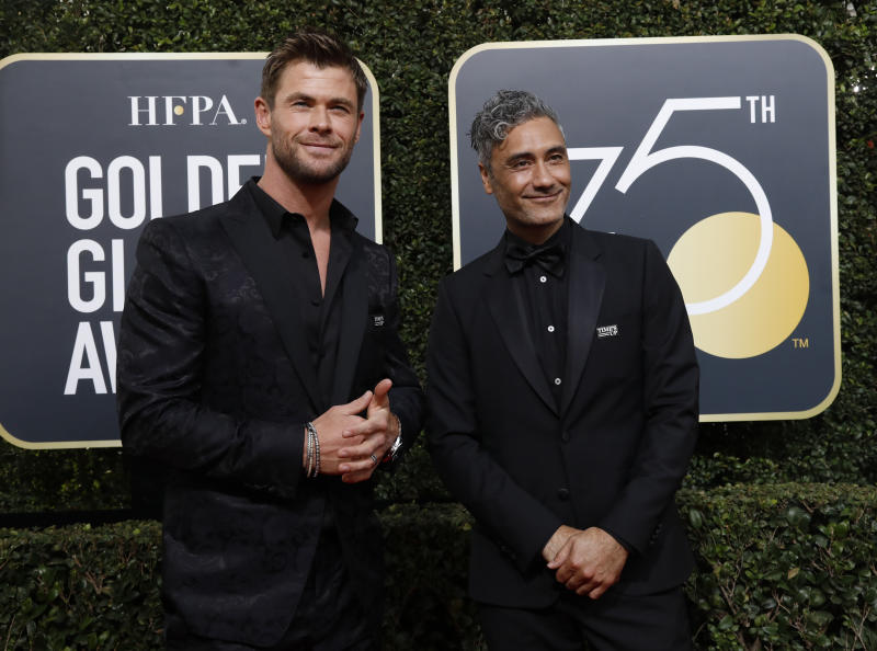 75th Golden Globe Awards – Arrivals – Beverly Hills, California, U.S., 07/01/2018 – Actors Chris Hemsworth (L) and Taika Waititi. REUTERS/Mario Anzuoni