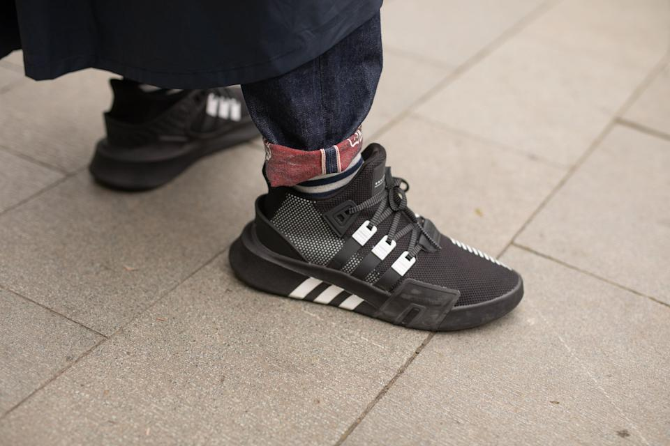 SHANGHAI,CHINA - APRIL 2: A guest is seen on the street attending Shanghai Fashion Week A/W 2019/2020 wearing Adidas sneakers on April 2, 2019 in Shanghai, China (Photo by Matthew Sperzel/Getty Images)