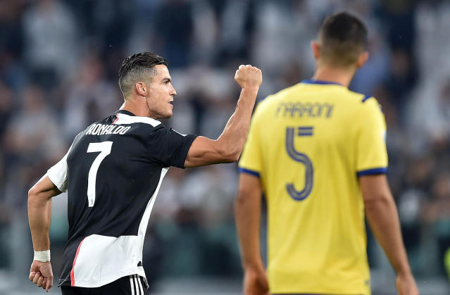 Juventus' Cristiano Ronaldo, left, celebrates with his teammates after scoring his side second goal on a penalty kick during the Italian Serie A soccer match between Juventus and Verona at the Juventus' Stadium in Turin, Italy, Saturday, Sept. 21, 2019. (Alessandro Di Marco/ANSA via AP)