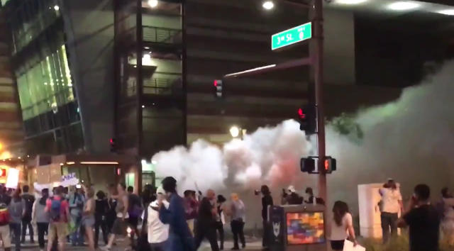 A screengrab from video of Phoenix police using pepper spray to disperse ant-Trump demonstrators on Aug. 22. (Video: Hunter Walker/Yahoo News)