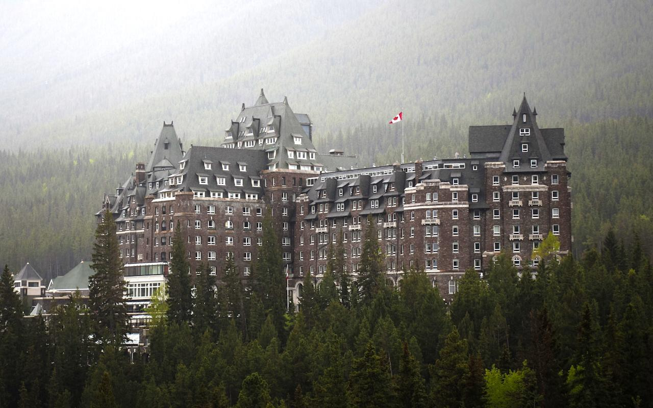 "Built in 1888 to encourage Western tourism and to sell train tickets, this <a href=""https://www.cntraveler.com/hotels/canada/banff/fairmont-banff-springs?mbid=synd_yahoo_rss"">chateau-style hotel</a> sits pretty by the Rocky Mountains in Banff National Park. But the Fairmont gets a tad more Gothic once you get inside—and we aren't talking about the architecture. Several ghosts have been reported as regulars, including a bride who supposedly fell down the stone staircase during her wedding. But there's a less tragic spirit, too: <a href=""https://www.atlasobscura.com/places/banff-springs-hotel"">Sam the bellman</a>, who worked at the hotel until 1975 and claimed he'd come back to haunt the joint. His spirit supposedly pulls shifts helping people with their bags before disappearing."