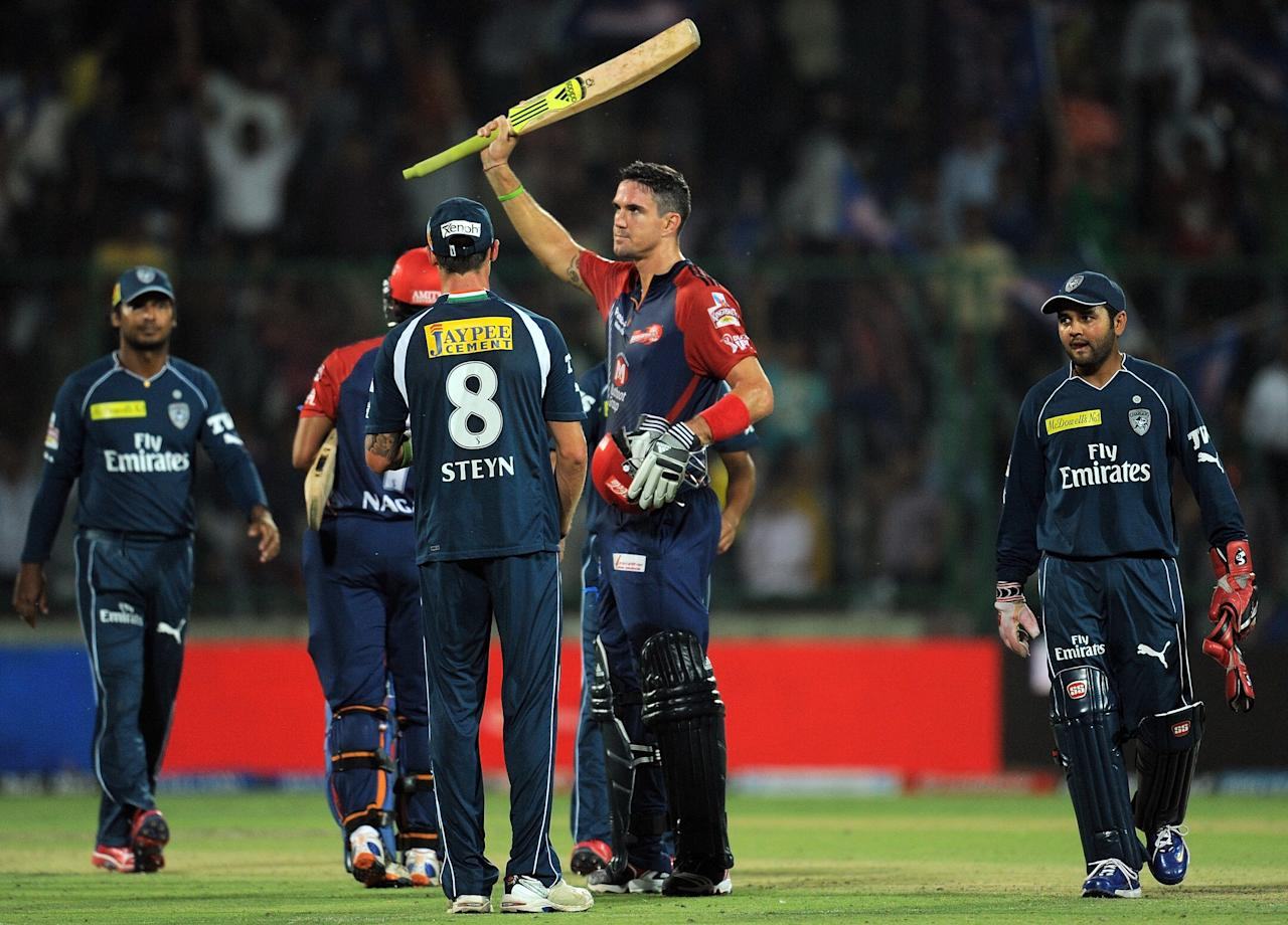 Delhi Daredevils batsman Kevin Pietersen (C) celebrates after scoring a century (100 runs ) during the IPL Twenty20 cricket match between Deccan Chargers and Delhi Daredevils at The Feroz Shah Kotla stadium in New Delhi on April 19, 2012. RESTRICTED TO EDITORIAL USE. MOBILE USE WITHIN NEWS PACKAGE. AFP PHOTO/ MANAN VATSYAYANA (Photo credit should read MANAN VATSYAYANA/AFP/Getty Images)
