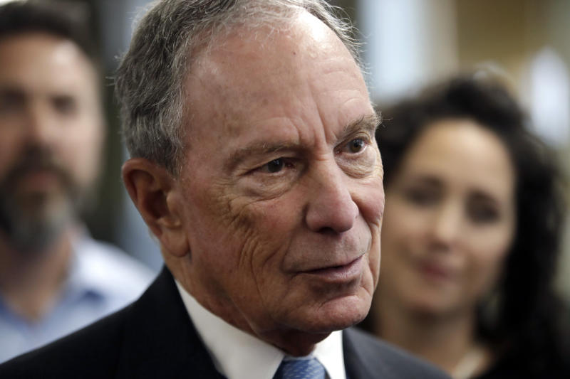 """FILE - In this Jan. 29, 2019 file photo, potential Democratic presidential candidate Michael Bloomberg speaks to workers during a tour of the WH Bagshaw Company, a pin and precision component manufacturer, in Nashua, N.H. Bloomberg, the billionaire former mayor of New York City, is opening the door to a 2020 presidential campaign. Bloomberg announced earlier this year that he would not seek the Democratic nomination. But in a statement, his political adviser Howard Wolfson says Bloomberg is worried that the current crop of Democratic presidential candidates is """"not well positioned"""" to defeat President Donald Trump. (AP Photo/Elise Amendola, File)"""