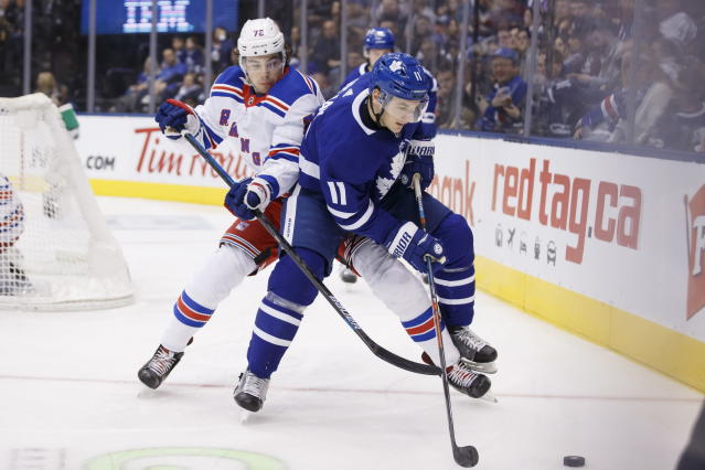 Toronto Maple Leafs left wing Zach Hyman (11) and New York Rangers center Filip Chytil (72) battle for the puck during second-period NHL hockey game action in Toronto, Saturday, Dec. 28, 2019. (Cole Burston/The Canadian Press via AP)