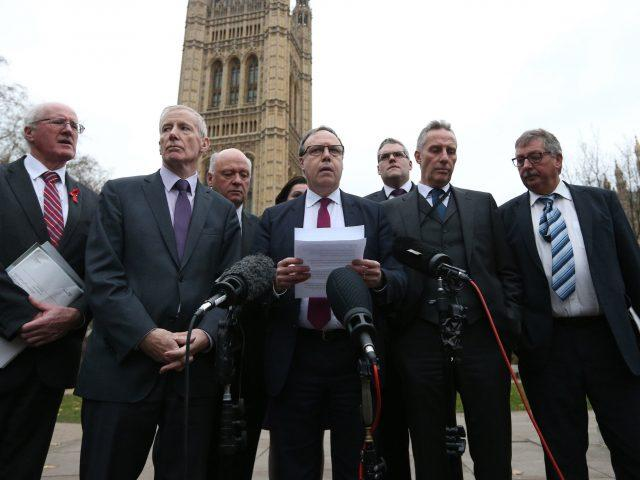 Deputy leader Nigel Dodds and fellow Westminster DUP MPs outside Parliament