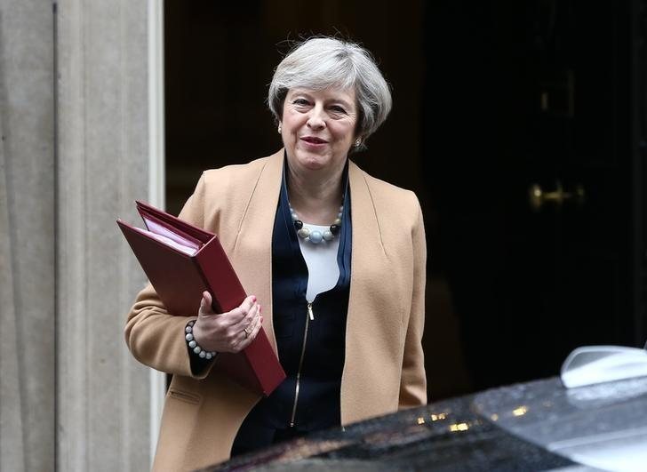 Britain's Prime Minister Theresa May leaves 10 Downing Street before Chancellor of the Exchequer Philip Hammond delivers his budget to the House of Commons in London