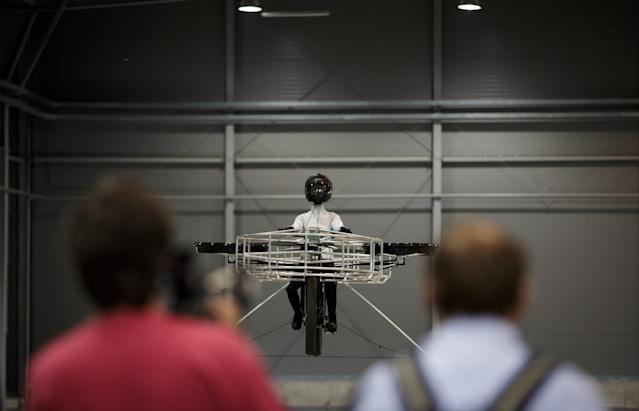 A 'Flying bike' bicycle flies during its first public flight on June 12, 2013 in Prague, Czech Republic. The bike has been manufactured by 3 different companies from the Czech Republic (Duratec, Technodat, Evektor) and has been supported by French Company Dassault System. The F-Bike has four main motors (10kW) and two stabilization motors (3,5 kW). It has an estimated constant flight time of 3-5 minutes. (Photo by Matej Divizna/Getty Images)