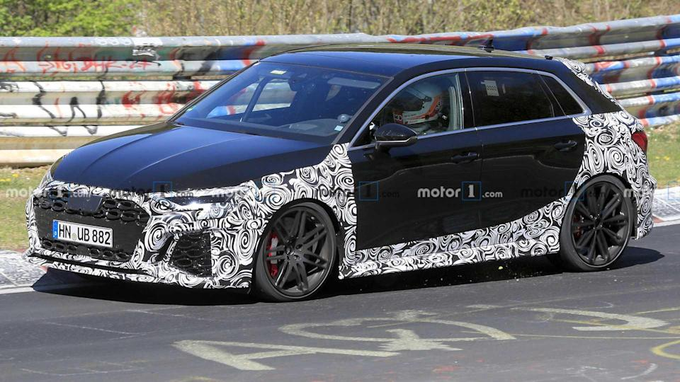 """<p>The latest spy video for the RS3 has us scratching our heads a bit. Is Audi testing out different exhaust systems for its hot hatchback?</p> <h3><a href=""""https://www.motor1.com/news/432081/2021-audi-rs3-spy-video/"""" rel=""""nofollow noopener"""" target=""""_blank"""" data-ylk=""""slk:2021 Audi RS3 Spied With Angrier Exhaust Note, Could Have 415 HP"""" class=""""link rapid-noclick-resp"""">2021 Audi RS3 Spied With Angrier Exhaust Note, Could Have 415 HP</a></h3> <br><a href=""""https://www.motor1.com/news/423778/2021-audi-rs3-nurburgring-spy/"""" rel=""""nofollow noopener"""" target=""""_blank"""" data-ylk=""""slk:2021 Audi RS3 Plays Its Unmistakable Inline-Five Sound In Spy Video"""" class=""""link rapid-noclick-resp"""">2021 Audi RS3 Plays Its Unmistakable Inline-Five Sound In Spy Video</a><br><a href=""""https://www.motor1.com/news/410634/audi-rs3-hatchback-spy-photos/"""" rel=""""nofollow noopener"""" target=""""_blank"""" data-ylk=""""slk:Audi RS3 Spied With Less Camouflage, Shows Off Broader Fenders"""" class=""""link rapid-noclick-resp"""">Audi RS3 Spied With Less Camouflage, Shows Off Broader Fenders</a><br>"""