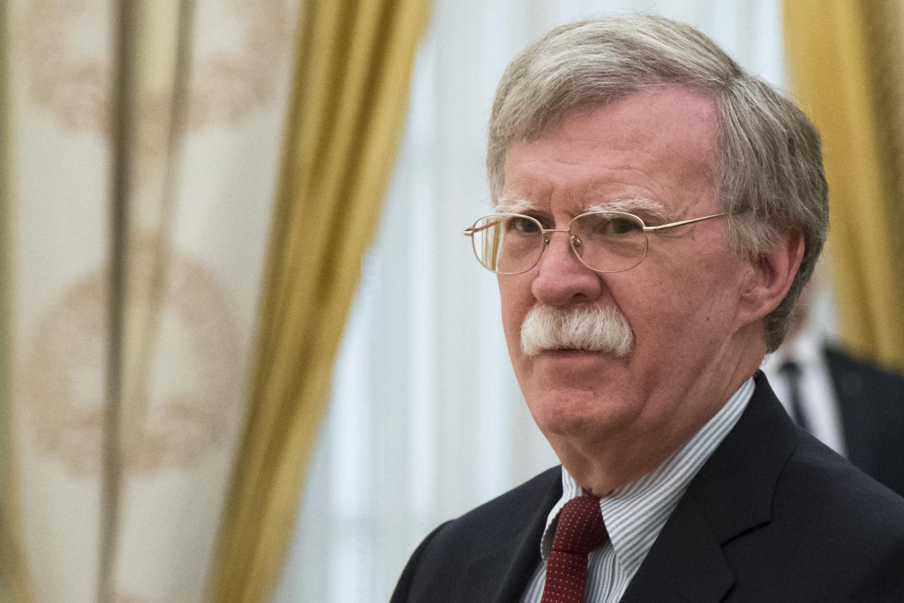 FILE - In this Wednesday, June 27, 2018 file photo, U.S. National security adviser John Bolton waits for the talks with Russian President Vladimir Putin in the Kremlin in Moscow, Russia. President Donald Trump's national security adviser is going to be raising thorny subjects with his counterparts in Moscow on a visit to help craft a script for another high-level meeting between Trump and Russia President Vladimir Putin. John Bolton leaves Saturday, Oct. 20, 2018 on a trip to Russia, Azerbaijan, Armenia and Georgia. (AP Photo/Alexander Zemlianichenko, Pool)