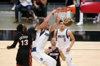 Dallas Mavericks center Dwight Powell (7) dunks the ball against Miami Heat center Bam Adebayo (13) and guard Goran Dragic (7) as guard Josh Green (8) looks on during the first half of an NBA basketball game, Tuesday, May 4, 2021, in Miami. (AP Photo/Wilfredo Lee)