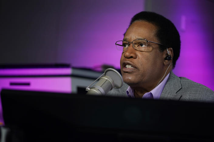 FILE — In this July 12, 2021 file photo radio talk show host Larry Elder speaks during his show, in Burbank, Calif. Alexandra Datig, Elder's former fiancee said Thursday, Aug. 19 that Elder, a candidate for governor in the Sept. 14 recall election, once displayed a gun to her during a heated argument in 2015. Elder said he never brandished a gun at anyone. (AP Photo/Marcio Jose Sanchez, File)