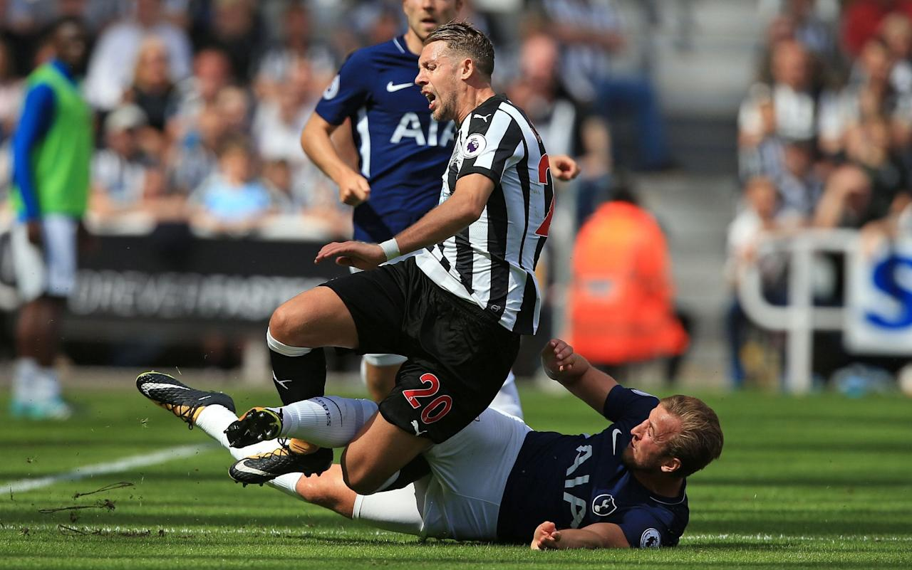 "Rafael Benítez insisted Jonjo Shelvey should not have been the only player to see red at St James' Park after claiming Harry Kane could also have been sent off for a first-half opening challenge on Florian Lejeune that saw Newcastle's debutant defender forced off with injury as Tottenham Hotspur launched their season with a comfortable 2-0 victory. The Spaniard refused to condemn Shelvey after the England midfielder left the hosts with a numerical disadvantage for more than 40 minutes when inexplicably but clearly intentionally standing on a prone Dele Alli as he attempted to lift the Tottenham player up off the turf. Shelvey faces a three-match suspension and a hefty club fine for his latest brush with officialdom, in the wake of serving a five-match ban for racially abusing the Wolverhampton Wanderers midfielder Romain Saiss last season. Asked if he felt let down by his stand-in captain, who led the side after Jamaal Lascelles was picked among the substitutes, Benítez said: ""He knows he's made a mistake and he's apologised afterwards in the dressing room. The rules are the rules, we made a mistake and we have to analyse it. Jonjo Shelvey was handed a straight red card after the Newcastle United midfielder appeared to stand on Tottenham Hotspur counterpart Dele Alli's hand at St James' Park on Sunday Credit: Getty Images ""For me the tackle from behind by Harry Kane was the worst. I had to change one of my players because of it. It did look like a scissor challenge, yes. Watching the replay from the bench with the fourth official, it's a surprise [that the player wasn't sent off]."" Listen to Total Football Podcast Benítez, though, was not unstinting in his support of 25-year-old Shelvey, who also had a red card against Nottingham Forest rescinded last season. Asked if the former Liverpool and Swansea player will remain as interim captain should Lascelles fail to return to the starting line-up, he replied: ""We will see in the future."" Premier League club-by-club verdict: Sam Wallace predicts who will finish where in 2017-18 Mauricio Pochettino defended Kane, who was booked for his reckless lunge at Lejeune, one of two defenders Newcastle lost to injury before half-time after full-back Paul Dummett limped off early on. The Tottenham manager insisted it was unfair to compare the two challenges. ""It's completely different,"" he said. ""For me, it's not fair to say to say the two incidents deserve the same punishment."" £250,000 up for grabs: pick your Telegraph Fantasy Football team today >>"