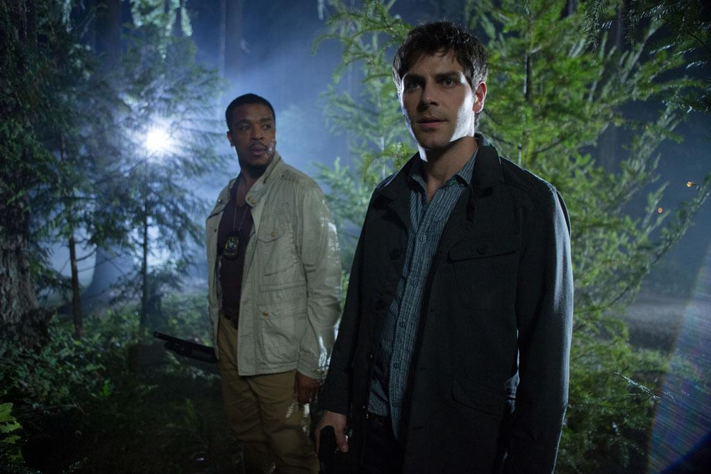"Russell Hornsby as Hank Griffin and David Giuntoli as Nick Burkhardt in the ""Grimm"" episode, ""Over My Dead Body."""