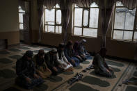 Afghan fighters stop at a local mosque for a prayer during a police patrol in search for a man accused of stabbing in Kabul, Afghanistan, Sunday, Sept. 12, 2021. The Taliban are shifting from being warriors to an urban police force. (AP Photo/Felipe Dana)